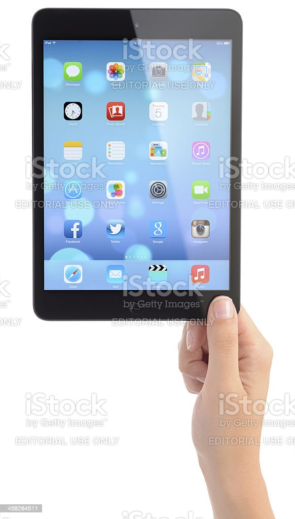 New iOS 7 operating system on Apple iPad Mini royalty-free stock photo