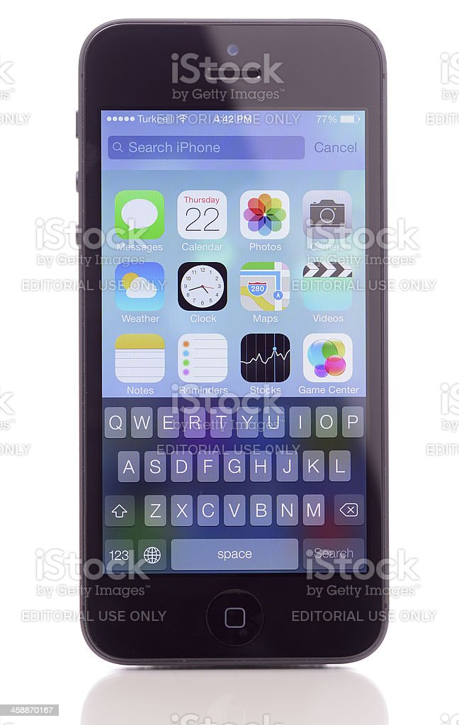 New iOS 7 operating system on iPhone 5 royalty-free stock photo