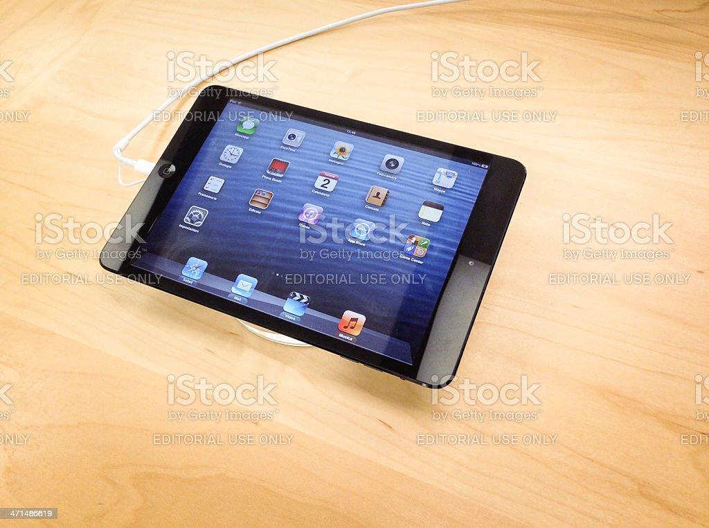 New Ipad Mini on wood table stock photo