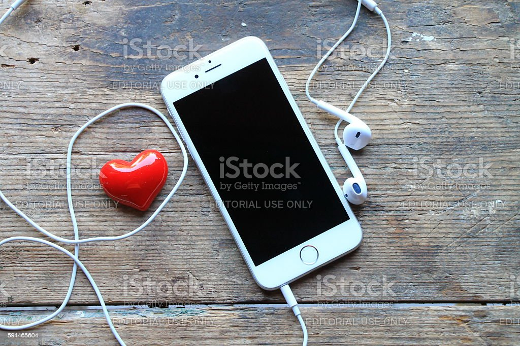 New iPhone 6 and red heart on the wooden table stock photo
