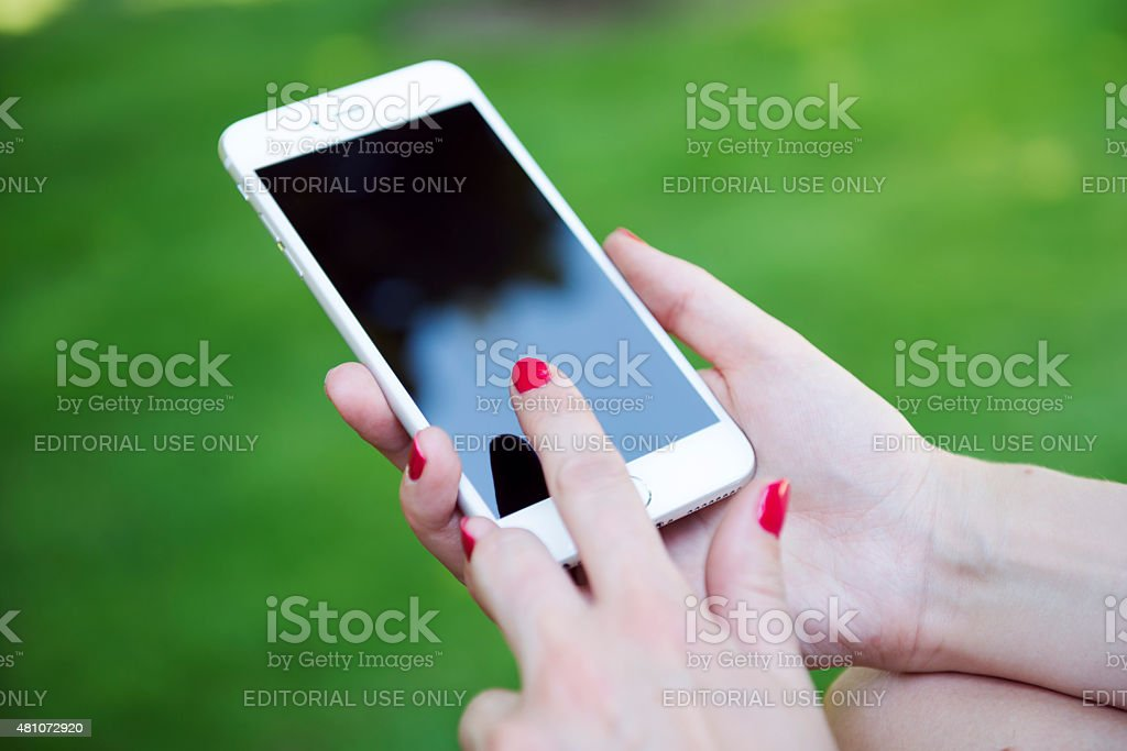 New iPhone 6 in woman's hand stock photo