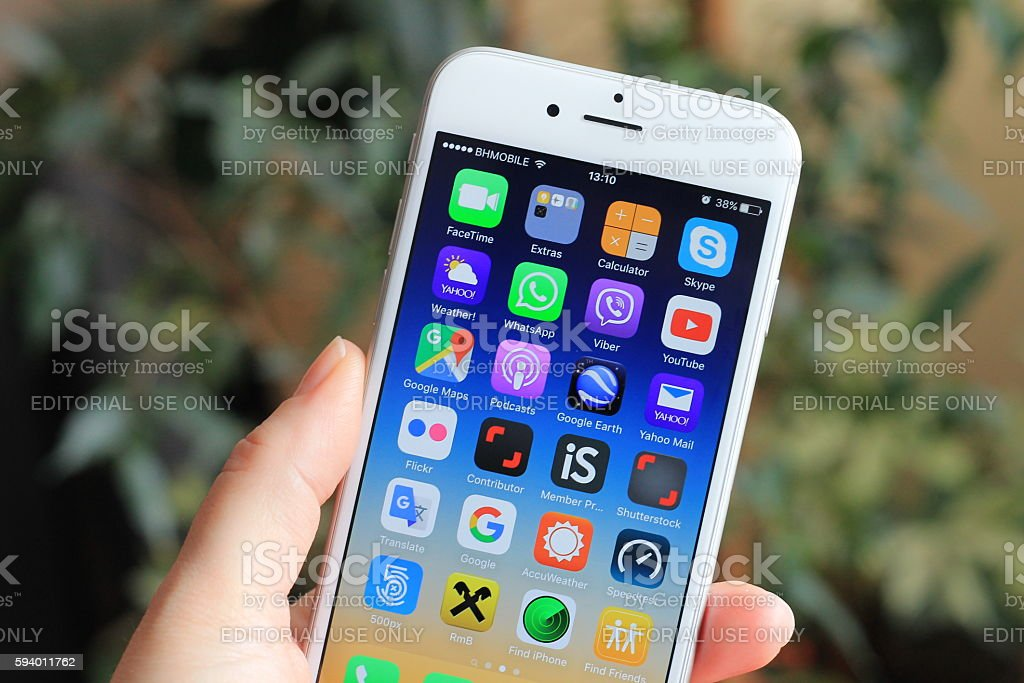 New iPhone 6 in woman's hand. stock photo