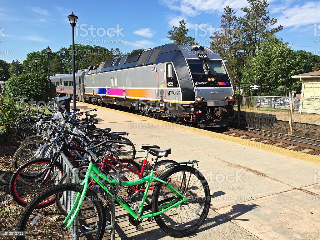 New Jersey Transit train arrives at station with bicycles stock photo