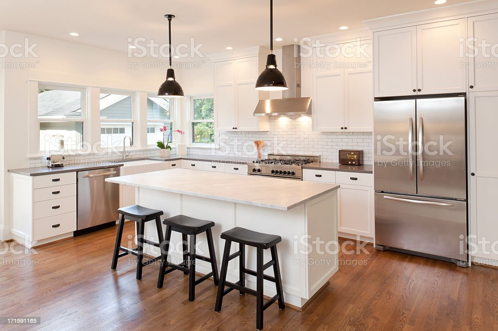 New kitchen in modern luxury home stock photo