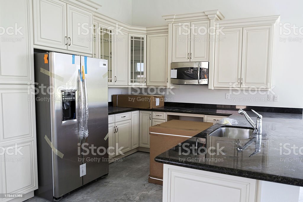 New kitchen with boxed appliances stock photo