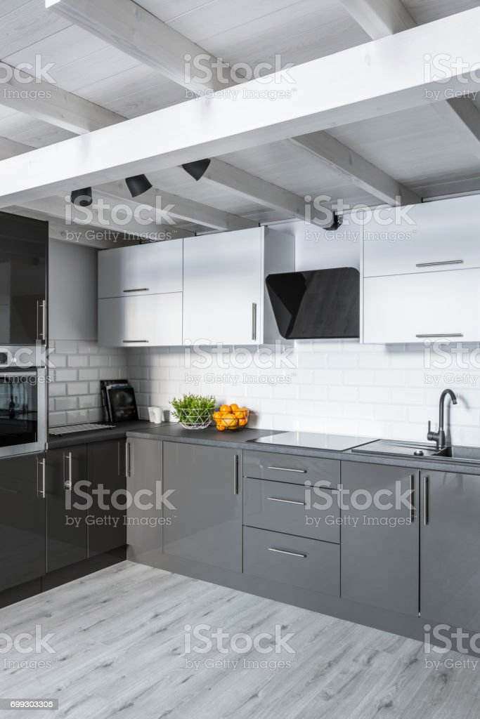 New kitchen with white brick tiles and wooden ceiling
