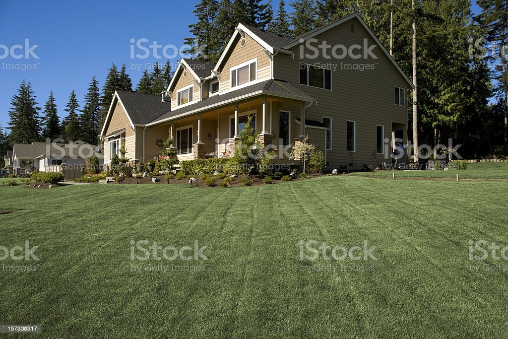 New Luxury home with lush landscaping royalty-free stock photo