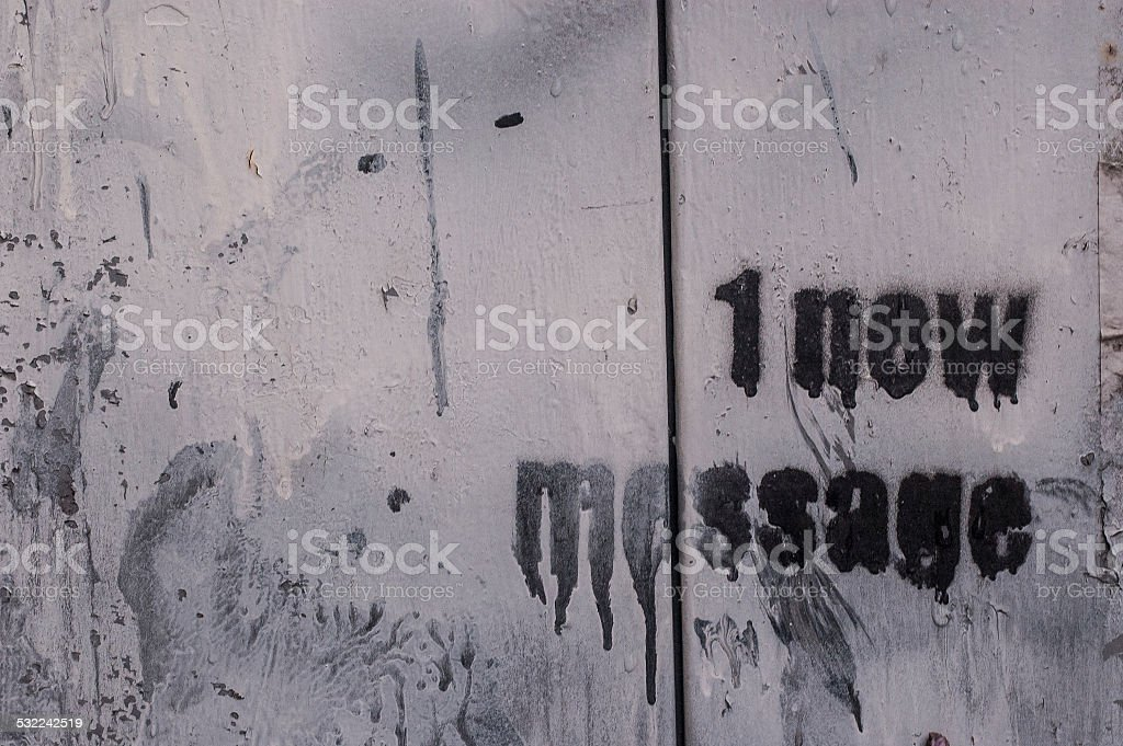 '1 new message' scribbled on a wooden white wall stock photo