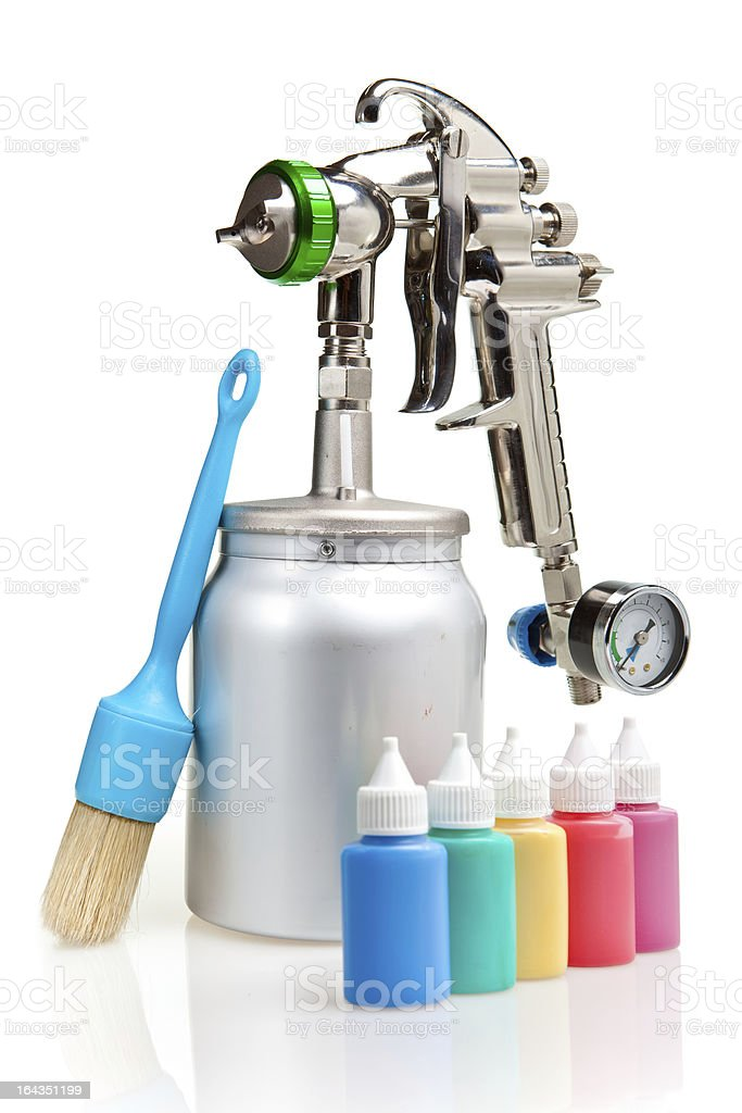 New metal brilliant Spray gun and small bottles with color royalty-free stock photo