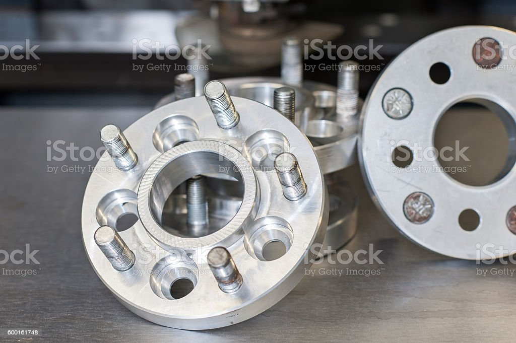 new metal mold of wheel spacers with bolts. CNC industry stock photo