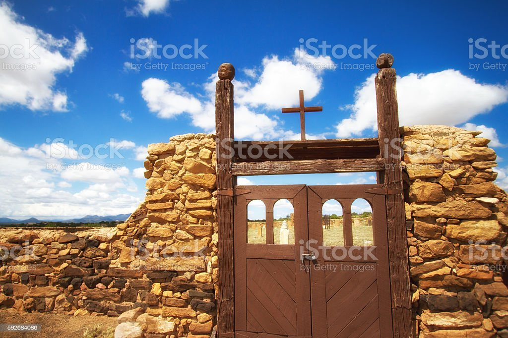 New Mexico: Cemetery Entrance with Stone Wall, Old Gates, Cross stock photo
