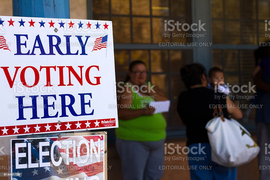 New Mexico: 'EARLY VOTING HERE' Sign, Voters in Background stock photo