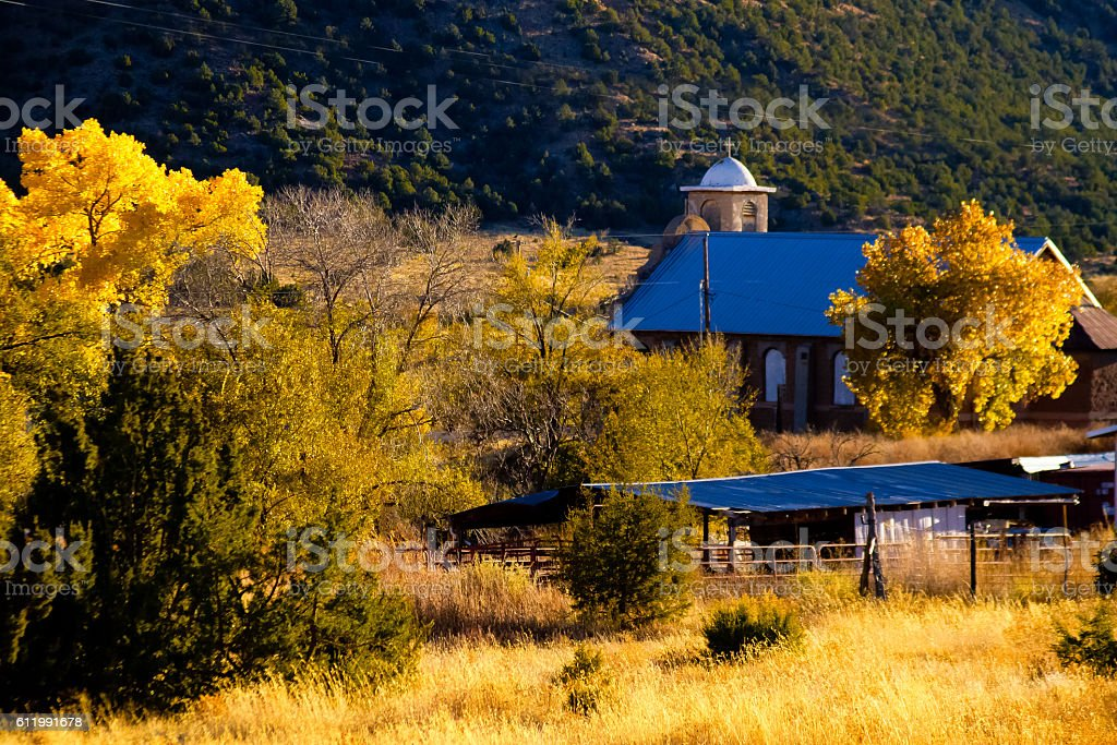New Mexico Vista: Autumn Cottonwood Trees, Old Adobe Church stock photo