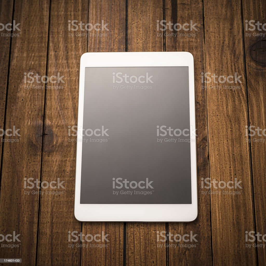New mini digital tablet on wood rustic table royalty-free stock photo