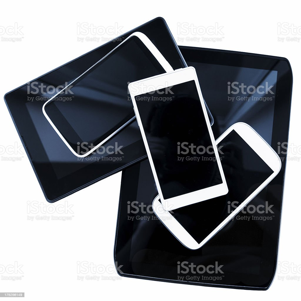 New mobile phones and digital tablets in a pile stock photo
