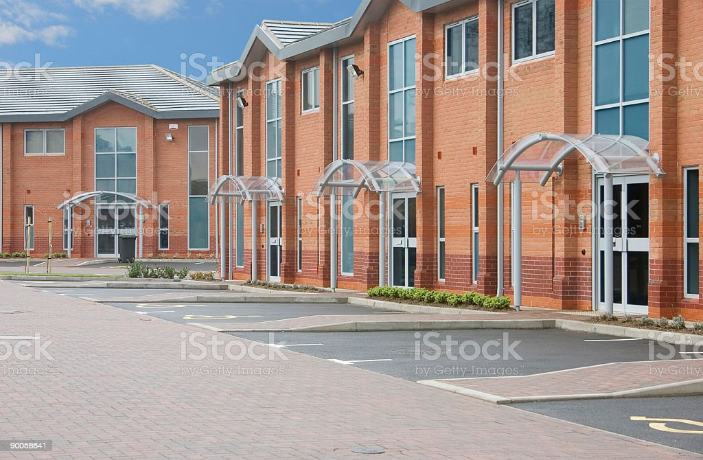 New modern brick offices with blue sky in background royalty-free stock photo
