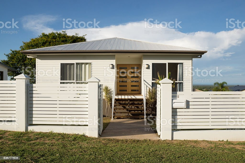 New modern contemporary house exterior with fence and front door stock photo
