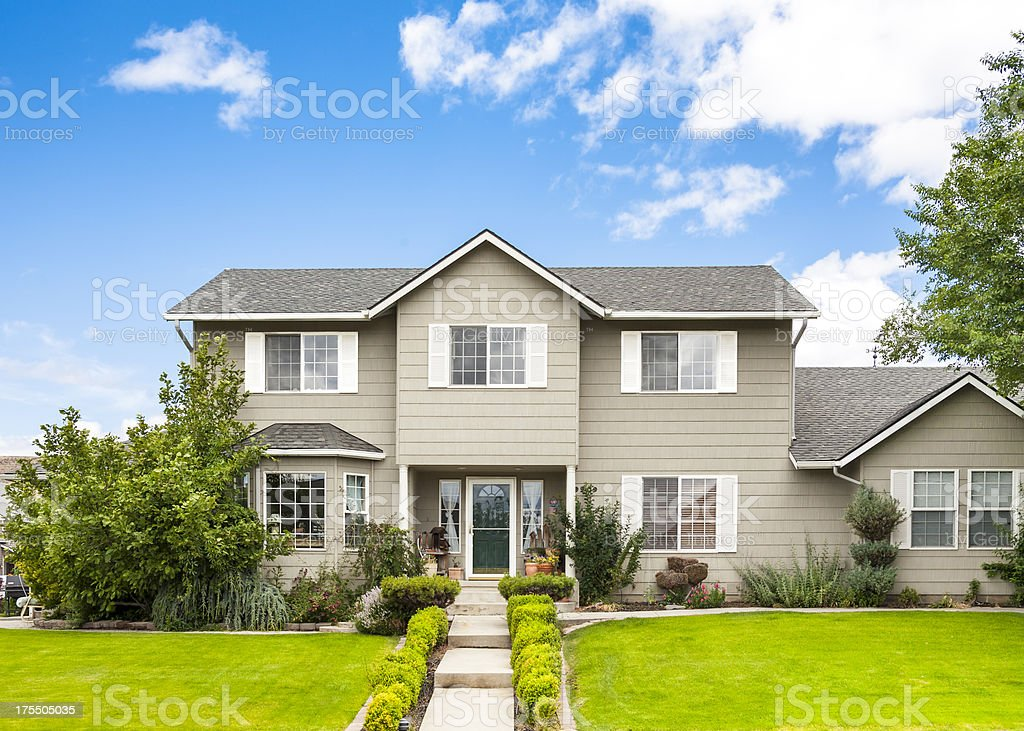 New modern home in gray with a green lawn stock photo