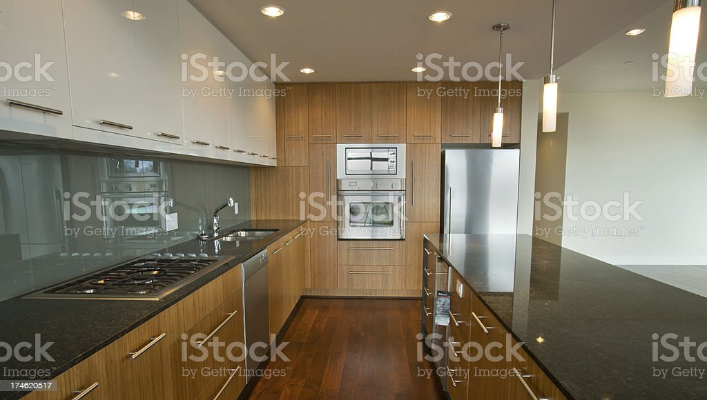 New Modern Kitchen with Granite Countertops royalty-free stock photo