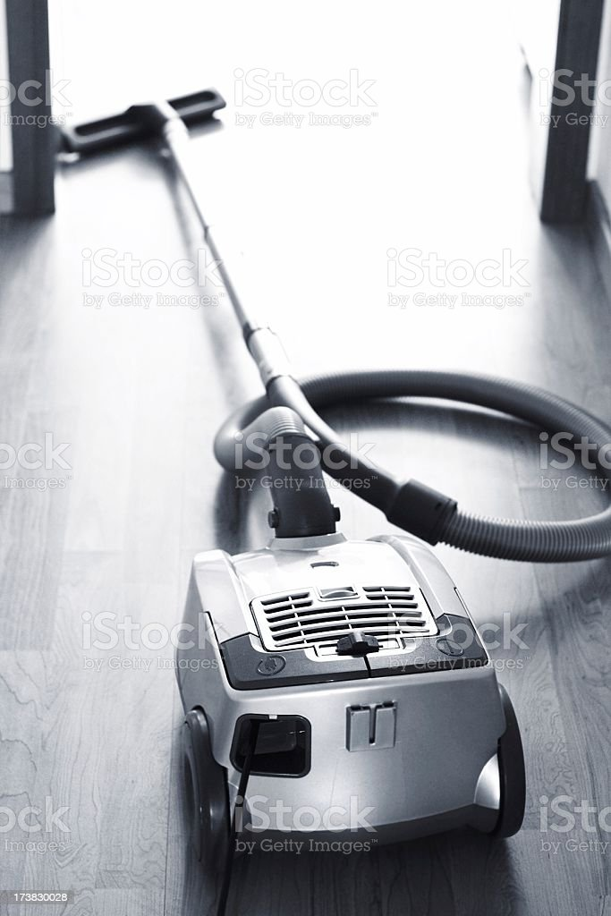 New modern vacuum cleaner lying in office room stock photo