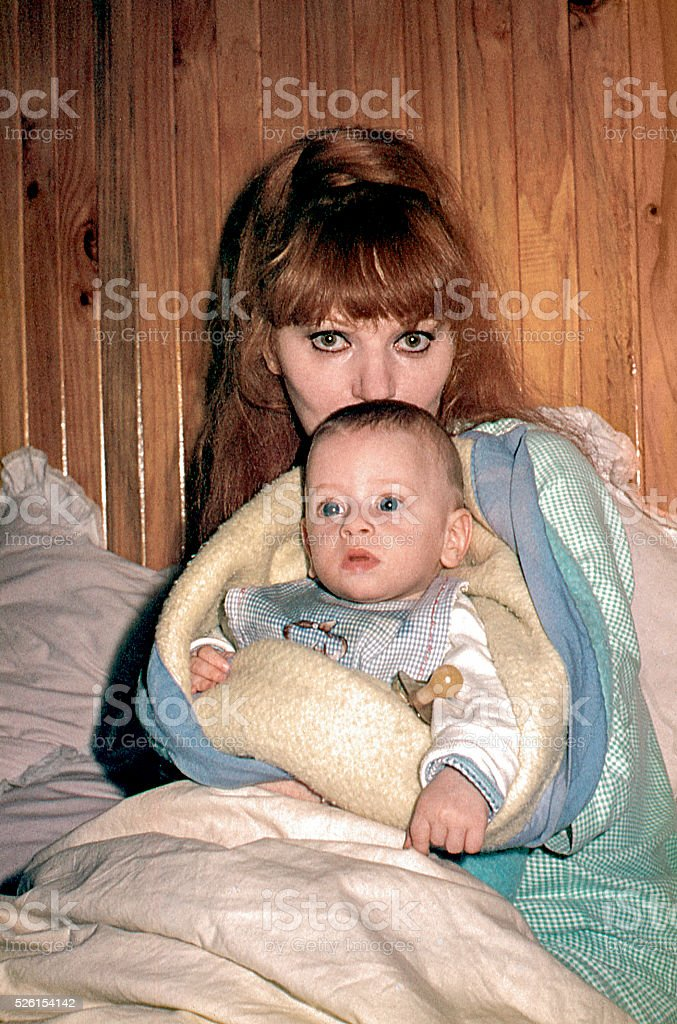 New mom with her baby boy stock photo
