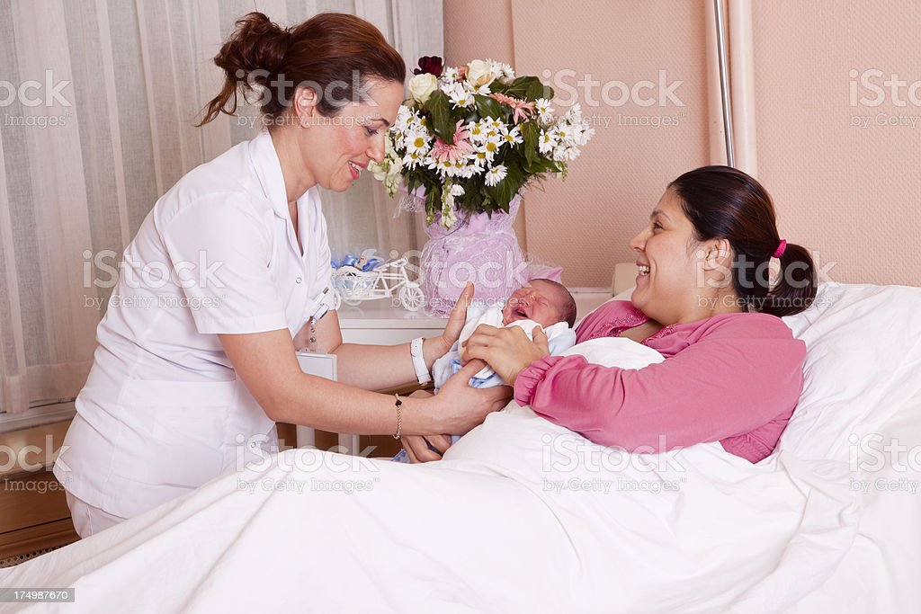 New mother with baby in hospital royalty-free stock photo