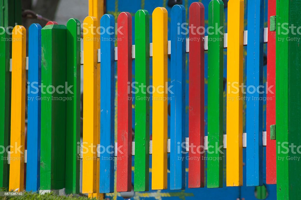New multicolored wooden fence stock photo