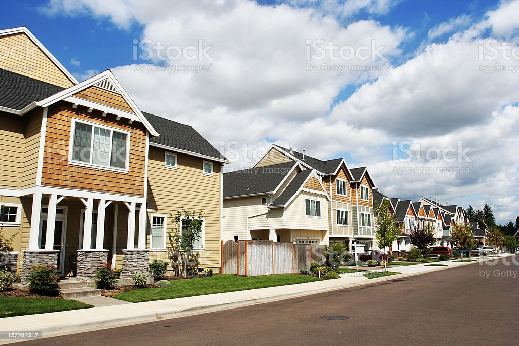 New Neighborhood with Blue Sky and Clouds stock photo