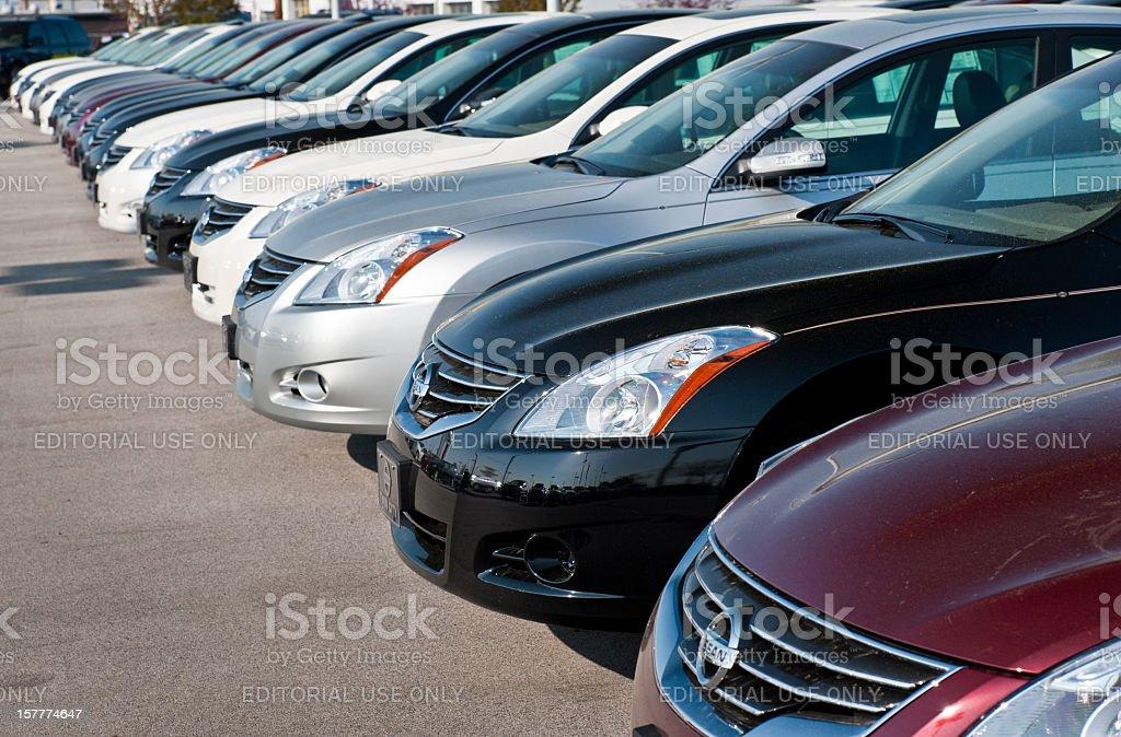 New Nissan Altima Sedans On Display At Dealership stock photo