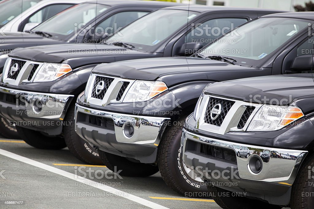 New Nissan Frontiers at a Car Dealership stock photo