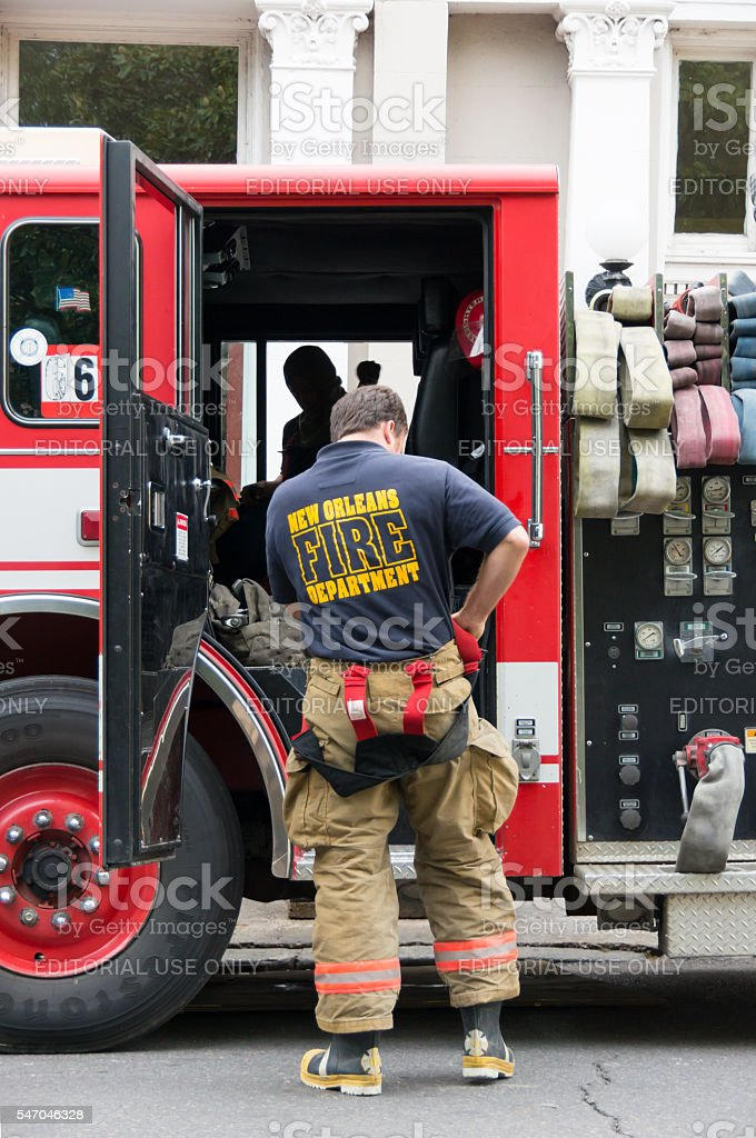 New Orleans Fireman suits up during an alarm stock photo