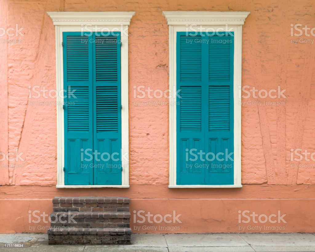 New Orleans French Quarter Peach House with Blue Shutters stock photo