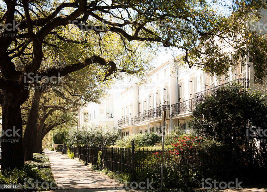 New Orleans, Louisiana, USA. Sidewalk, French Quarter old home. Trees. stock photo