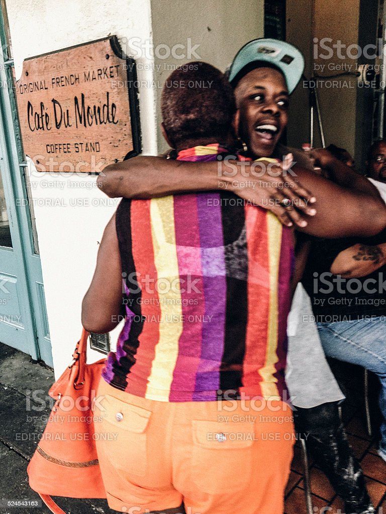New Orleans street scene with women hugging stock photo