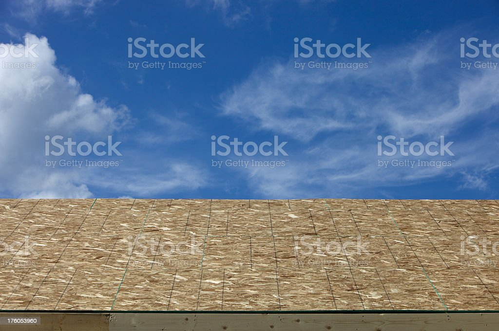 New OSB Roof Sheathing and Blue Sky stock photo
