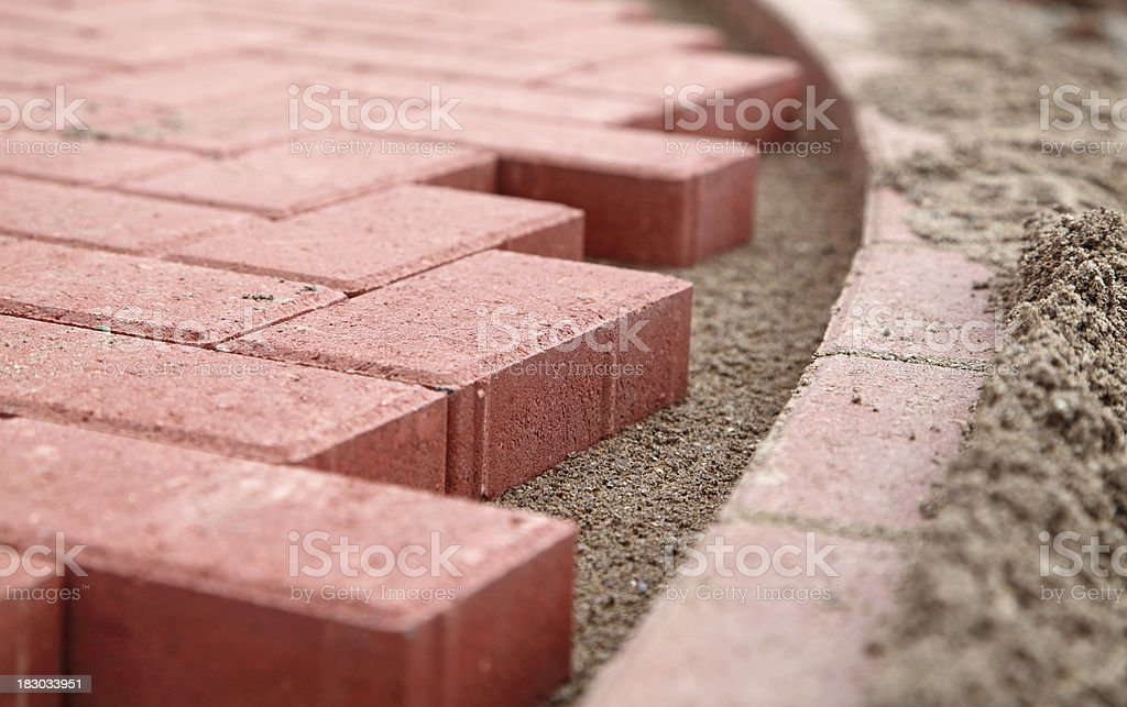 new path of red block paving stock photo