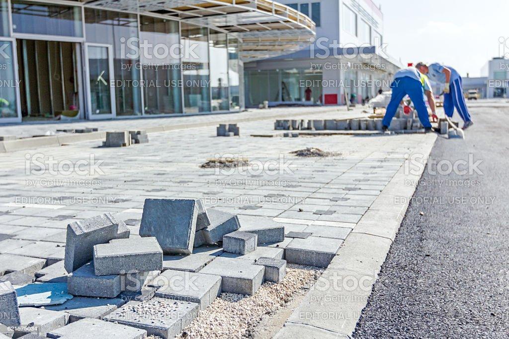 New pavement, still under construction, cobblestone blocks on ro stock photo