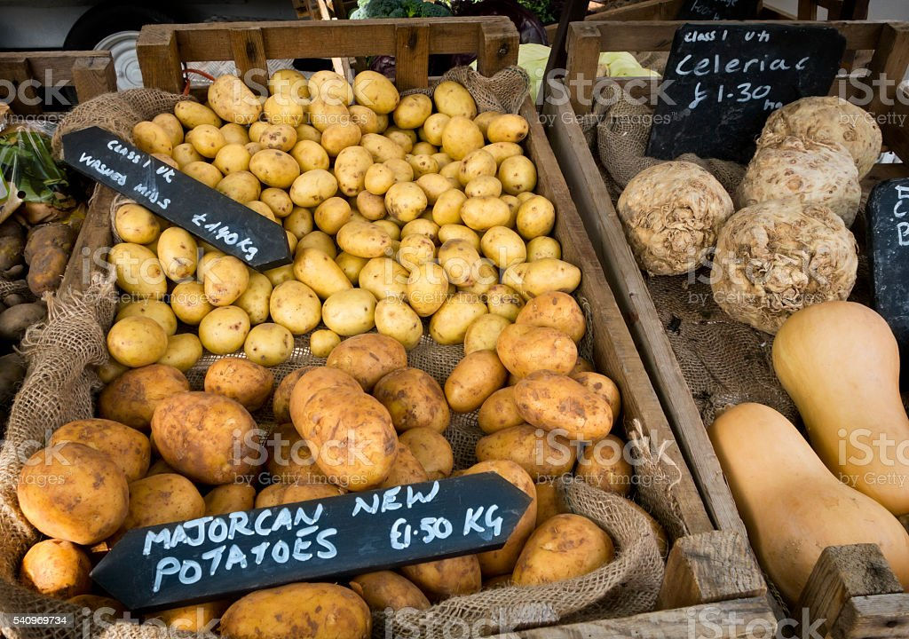 New potatoes on a market stall stock photo