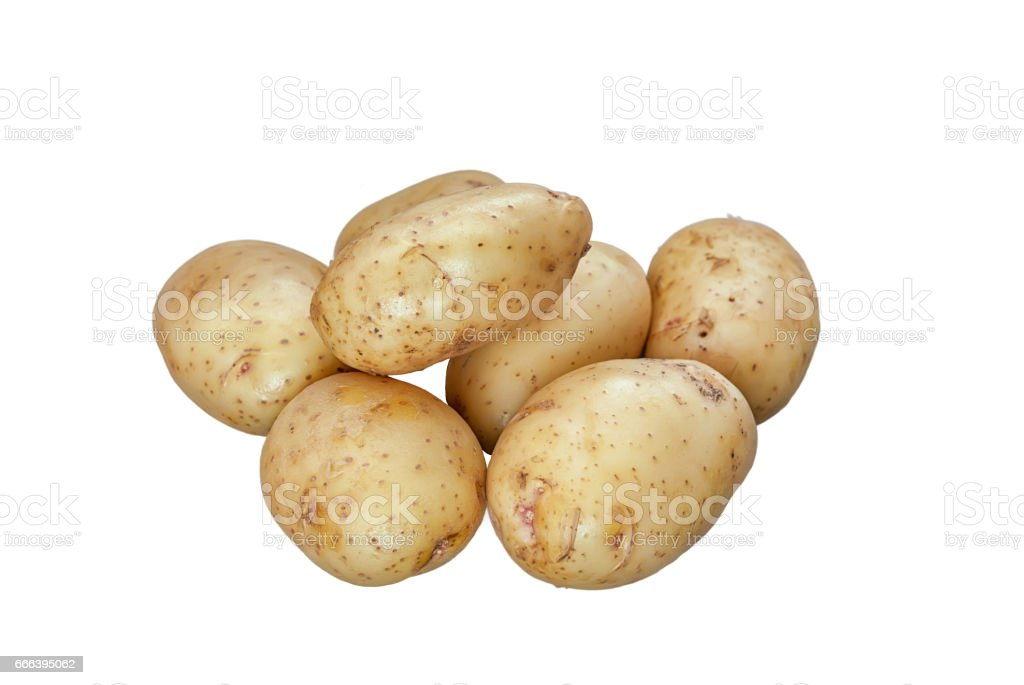 new potatoes ripe round group lying on a white background isolate stock photo