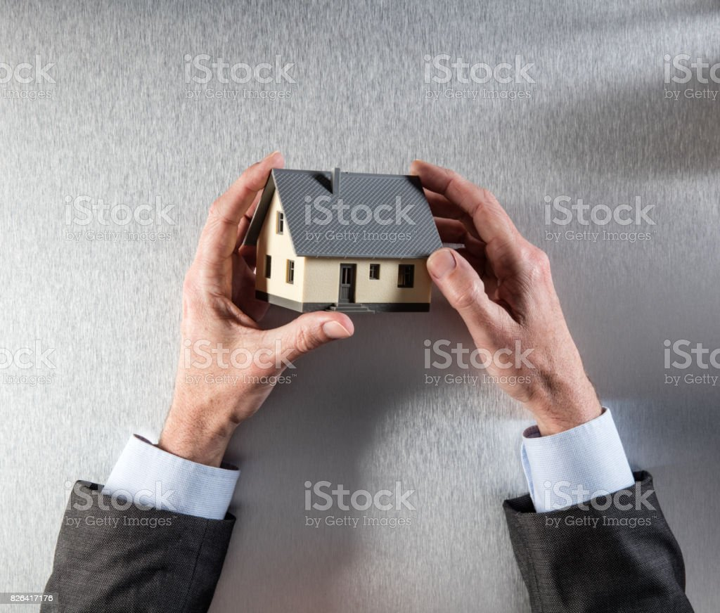 new property owner hands thinking about home for house valuation stock photo