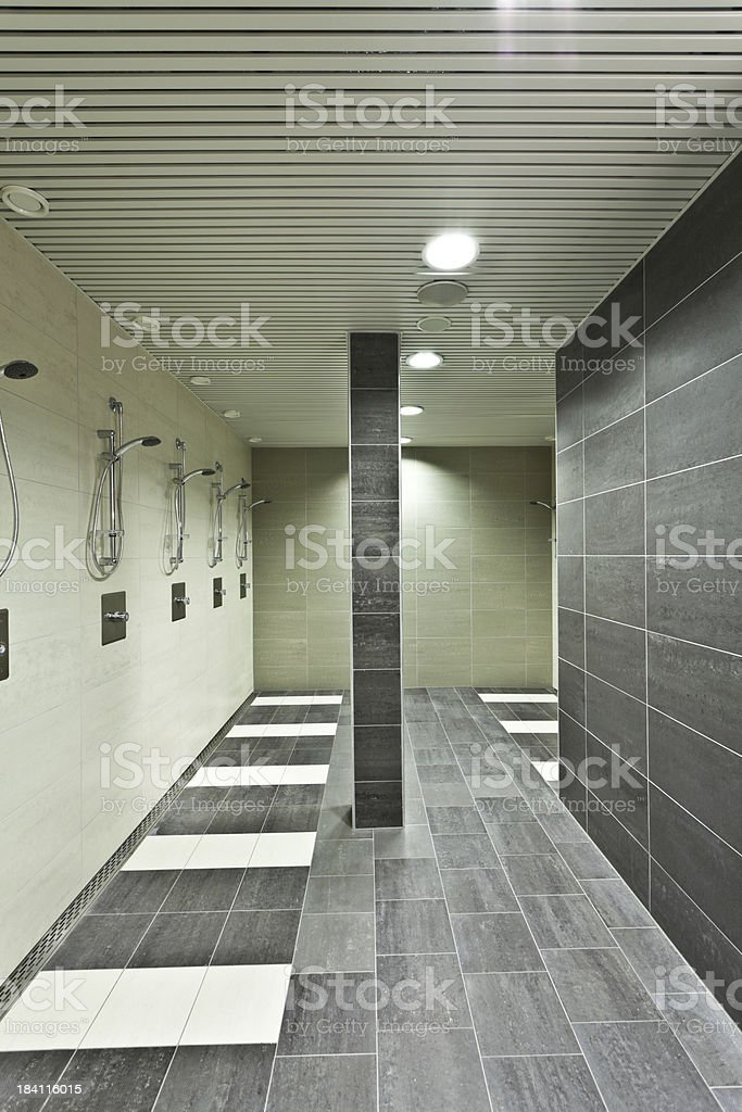 new public bathroom with many showers royalty-free stock photo