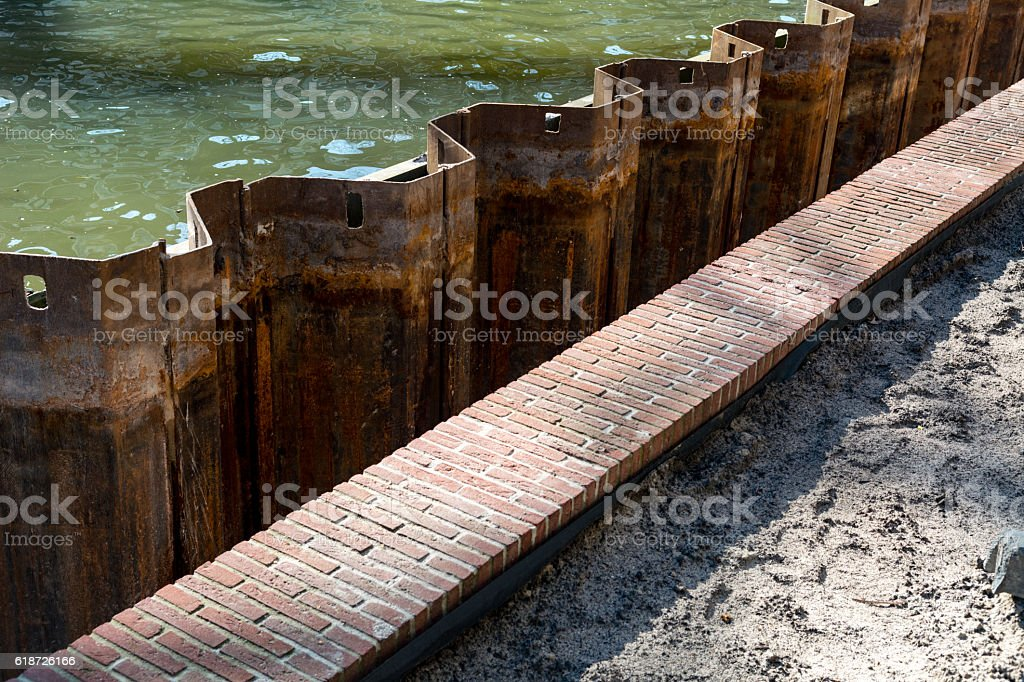 new quay wall construction in the dutch canal in sunlight stock photo