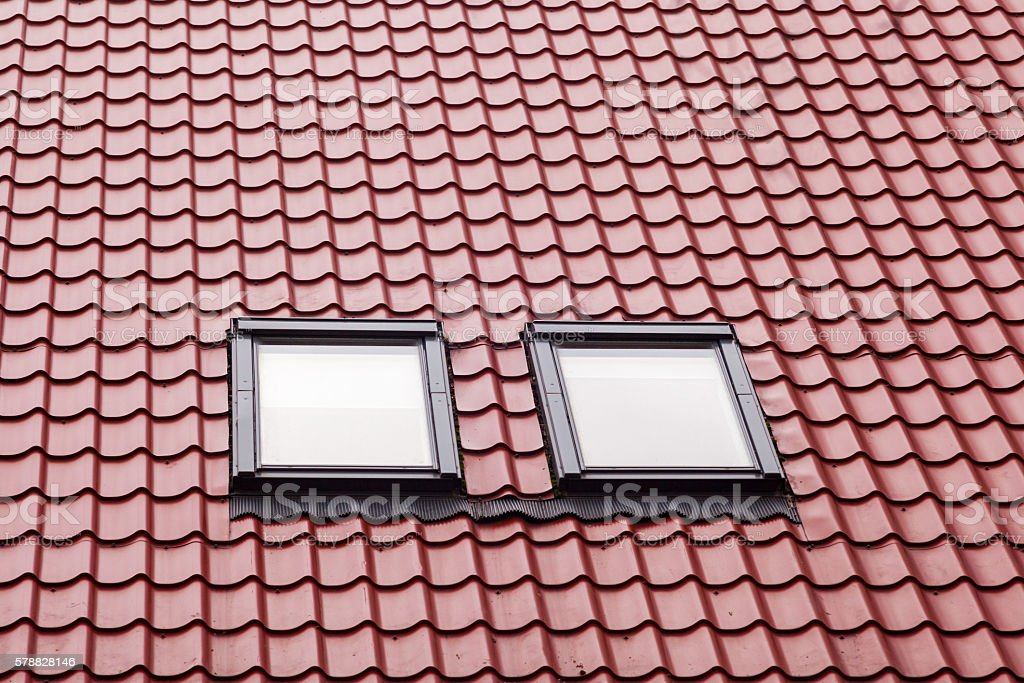 New red metal roof with skylights stock photo