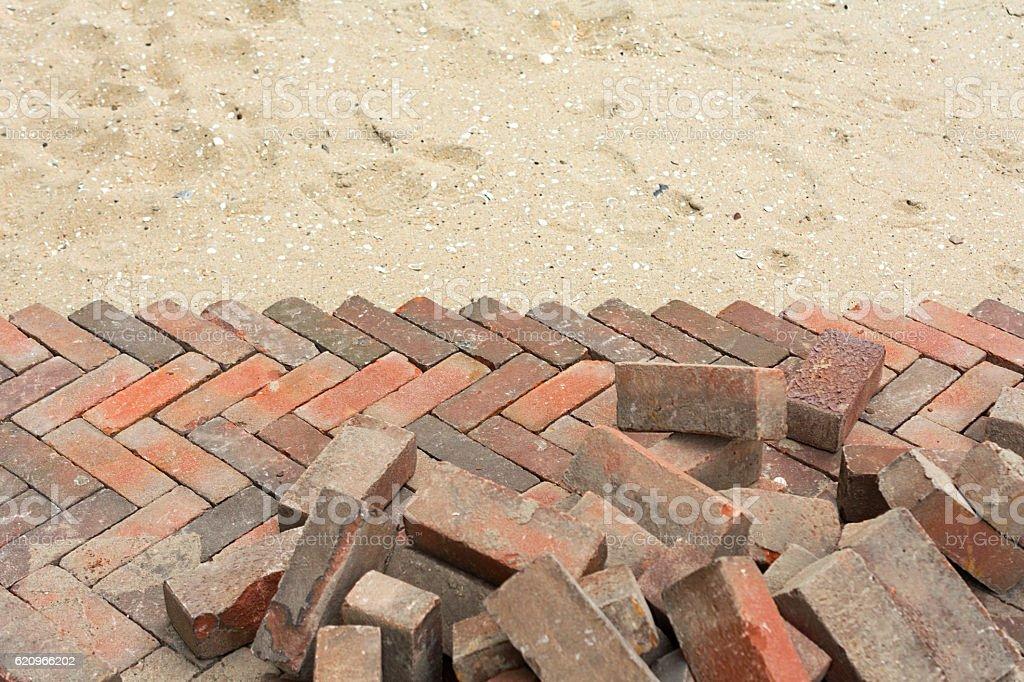 new red pavement fishbone pattern street stock photo