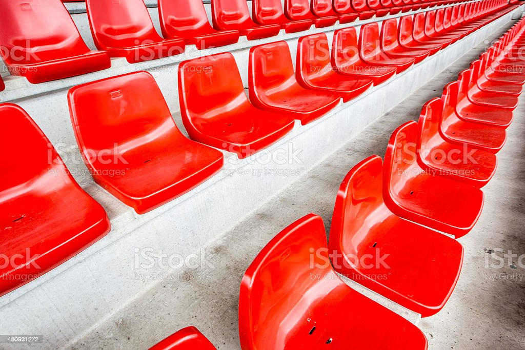 New red stadium seats on concrete stands stock photo