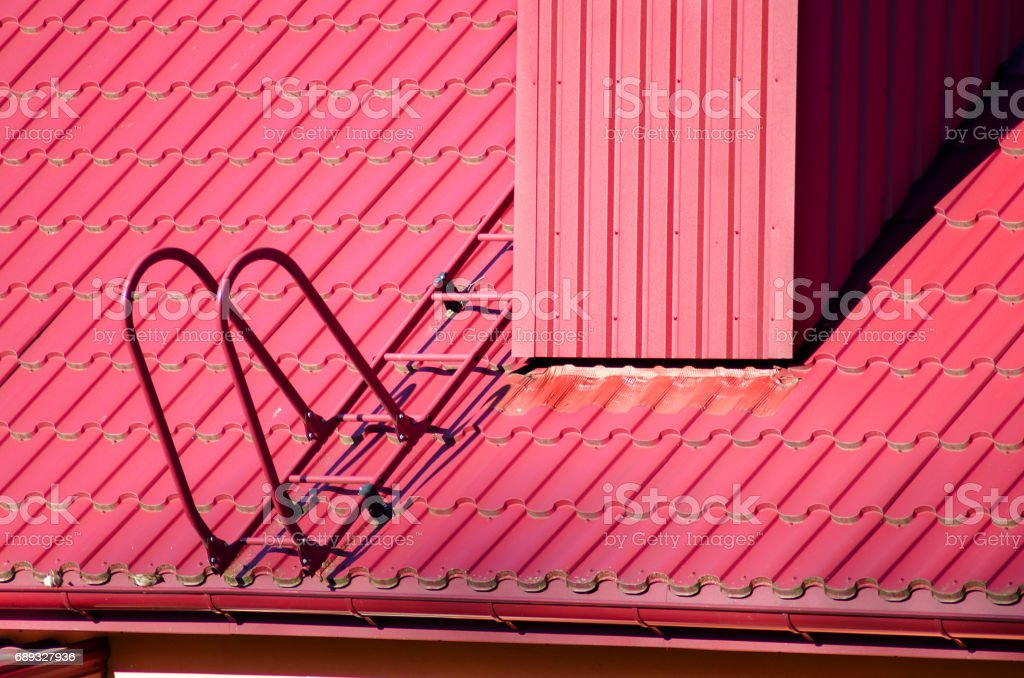 New red tiled roof and ladder stock photo