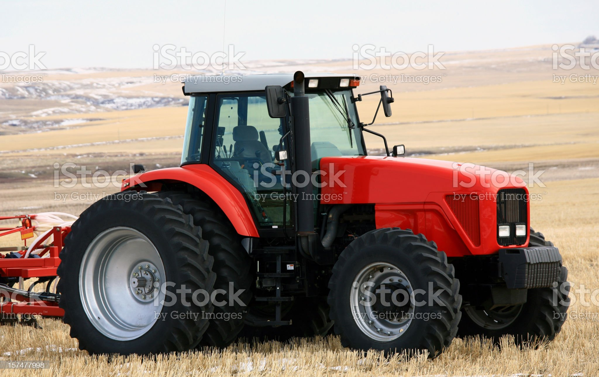 New Red Tractor on the Prairie With Cultivator royalty-free stock photo