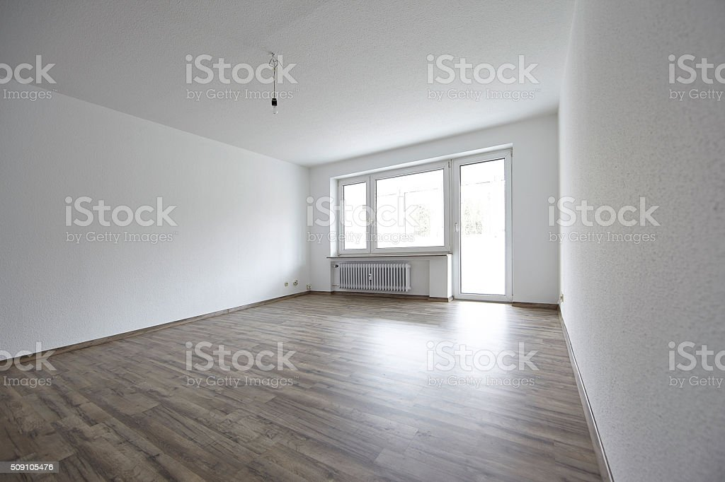 New renovated empty apartment with dark parquet floor stock photo