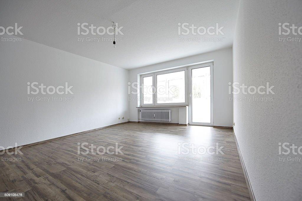 New renovated empty apartment with dark parquet floor stock photo