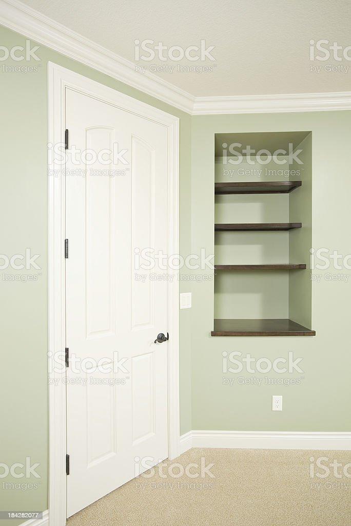 New Residential Bedroom Door and Built-in Shelf stock photo